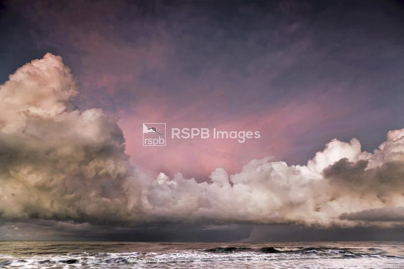 Dramatic oncoming winter storms at sunset, North Norfolk coastline, January ...