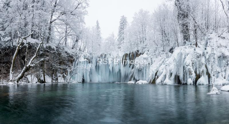 Icicles hang from a frozen waterfall, Plitvice Lakes National Park, Croatia ...