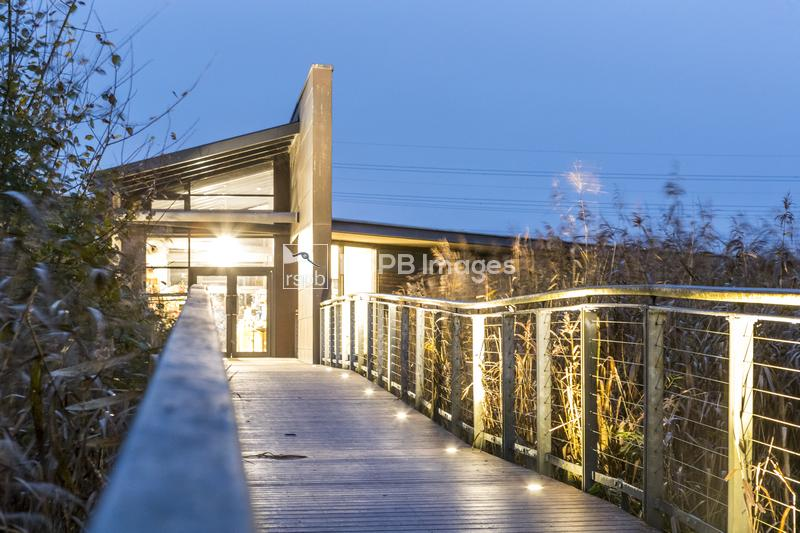 Walkway up to the RSPB visitor centre, RSPB Reserve Newport Wetlands, Gwent ...