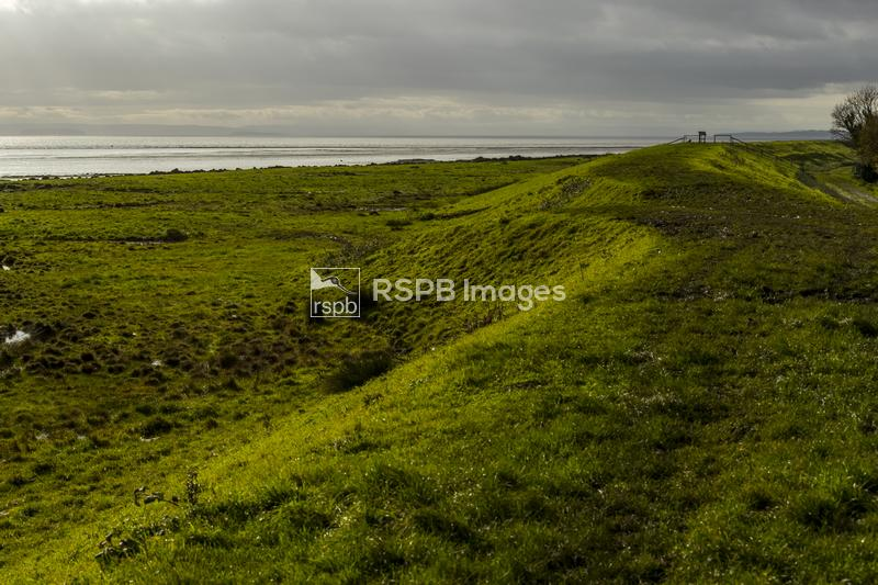 Stormy weather over the Bristol Channel seen from the St Brides sea wall, N ...